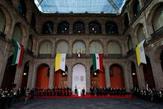 Pope Francis attends a welcoming ceremony with Mexican President Enrique Pena Nieto and first lady Angelica Rivera at the National Palace in Mexico City Feb. 13.