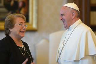 Pope Francis and Chilean President Michelle Bachelet laugh during a private audience at the Vatican June 5.