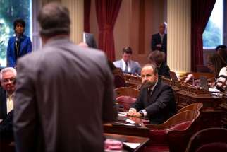 California state Sen. Jerry Hill, a Democrat, listens to another state legislator on the Senate floor at the California Capitol in Sacramento May 9, 2019. In a last-minute twist, a California bill that would have required priests to break the sacramental seal of confession was shelved July 8 by Hill amid a grassroots campaign mounted by the state's Catholics, members of other faith groups and religious liberty advocates from across the United States.