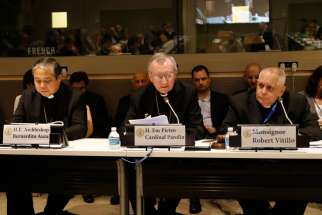Cardinal Pietro Parolin, Vatican secretary of state, speaks during a high-level side event Sept. 19 at the United Nations on the role of religious organizations in responding to the ongoing refugee and migration crisis affecting many areas of the world. Also pictured are Archbishop Bernardito Auza, left, the Vatican's permanent observer to the U.N., and Msgr. Robert J. Vitillo, secretary-general of the International Catholic Migration Commission.
