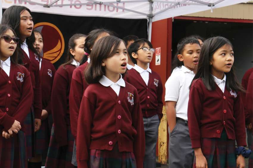 "Grade 5 students sing ""O Canada"" at the opening of the new fine arts annex at St. Mary's Elementary School in Vancouver."
