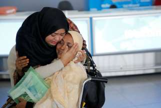 A woman greets her mother after she arrived from Dubai at John F. Kennedy International Airport in New York City Jan. 28. Three U.S. bishops' committee chairmen expressed deep concern over religious freedom issues regarding president Donald Trump's refugee ban.