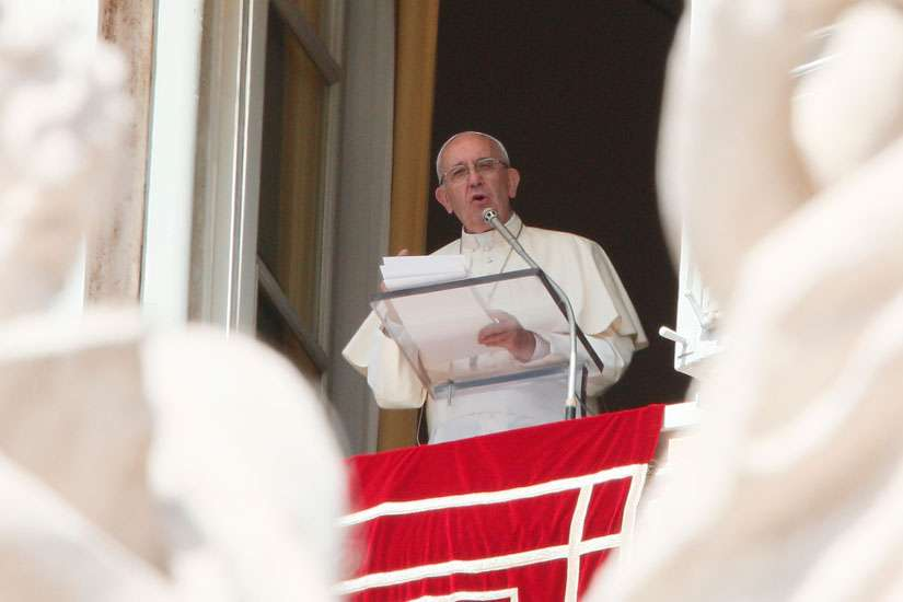 Pope Francis leads the Angelus from the window of his studio overlooking St. Peter's Square at the Vatican Sept. 18.