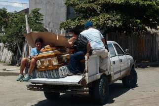 Relatives carry the coffin of a relative on a vehicle in Pedernales, Ecuador, April 17, after an earthquake struck the previous day off the country's Pacific coast. At least 272 people died, nearly 3,000 were injured and thousands were left homeless in the magnitude-7.8 earthquake.