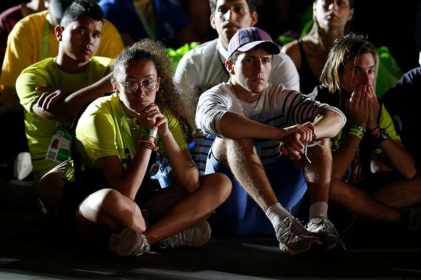 Young people attend the World Youth Day vigil at St. John Paul II Field in Panama City Jan. 26, 2019.