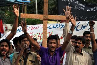 Pakistani members of the Christian minority shout slogans during a Nov. 9 protest in Karachi, Pakistan, against the killing of a Christian couple accused of blasphemy. The Catholic Church in Pakistan has presented a series of demands to the government, c alling for a fair and thorough investigation into the beatings and burning of the young Christian couple accused of desecrating the Quran.
