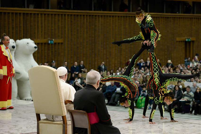 Members of Italy's Golden Circus perform for Pope Francis during his general audience in Paul VI hall at the Vatican Dec. 27.