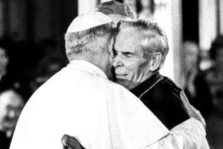 Then-Pope John Paul II is seen in an undated photo embracing Archbishop Fulton J. Sheen. Archbishop Sheen, the famed media evangelist, mission promoter and author, who will be beatified Dec. 21, 2019, at St. Mary's Cathedral in Peoria, Ill.