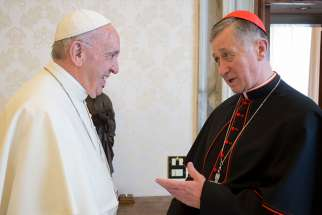 Pope Francis greets Cardinal Blase J. Cupich of Chicago during a meeting in the Apostolic Palace at the Vatican May 17.