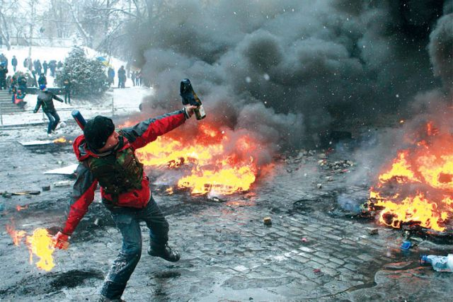 A pro-European Union protester throws a Molotov cocktail during clashes with riot police in Kiev, Ukraine, Jan. 22.