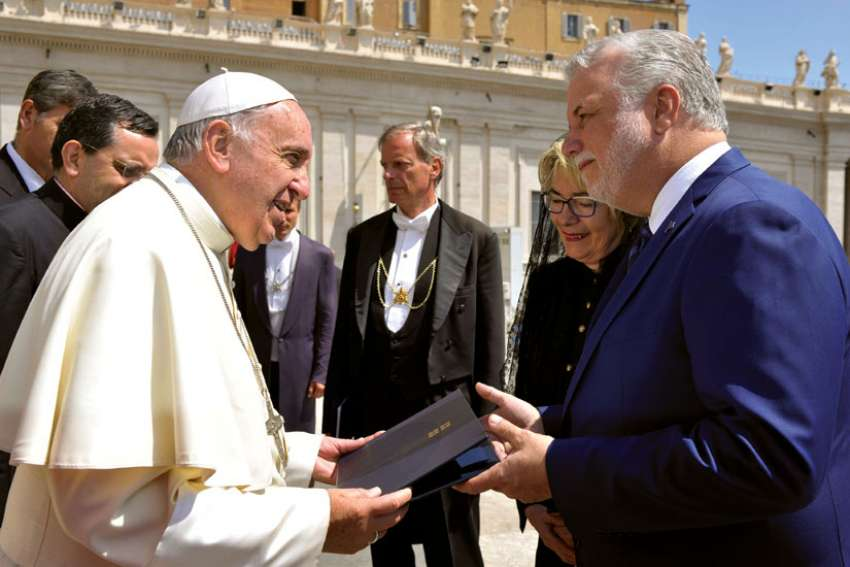 Pope Francis accepts an official invitation to visit Montreal from Quebec Premier Philippe Couillard during his general audience in St. Peter's Square at the Vatican May 27. The Pope was invited to visit Montreal in 2017 for the city's 375th anniversary.