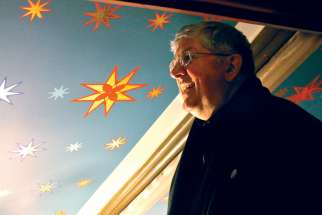 Cardinal Thomas Collins gets an up-close look at the cathedral's starry ceiling.