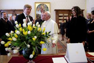 Pope Francis talks with King Willem-Alexander and Queen Maxima of the Netherlands during a private meeting at the Vatican June 22.
