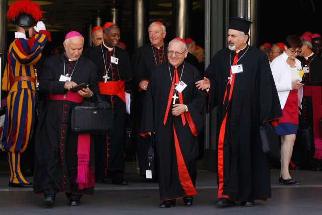 Archbishop Louis Sako of Baghdad, Iraq, patriarch of the Chaldean Catholic Church, center, and other prelates leave the opening session of the extraordinary Synod of Bishops on the family at the Vatican Oct. 6.
