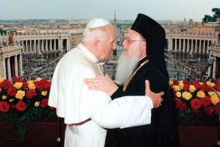 St. Pope John Paul II and Ecumenical Patriarch Bartholomew of Constantinople embrace following three days of private meetings at the Vatican in 1995.