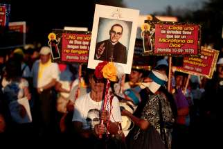 An image of Blessed Oscar Romero is seen during a March 26 procession in San Salvador, El Salvador, to commemorate the 37th anniversary of the March 24, 1980, murder of the archbishop.