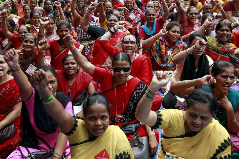 Workers from various trade unions shout slogans during an anti-government protest rally, organized as part of a nationwide strike, in Mumbai, India, Sept. 2.