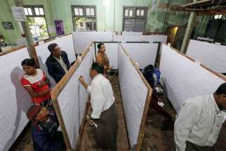 People check their names on final voter list displayed at a polling station in Mandalay, Myanmar, Nov. 1. Myanmar will hold its nationwide general elections Nov. 8.