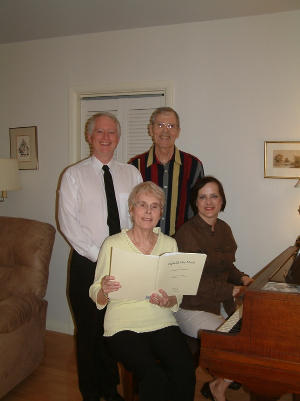 Joan Maloney (bottom left) and Michael Maloney (top right) prepare for their May 29 concert at St. Mary's Catholic Church in Simcoe, Ont., with accompanist Linda Bonadeo-Boll (bottom right) and reader Michael Fidler (top left).