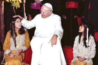 Pope John Paul II meets with Native children in his 1984 visit to Canada.