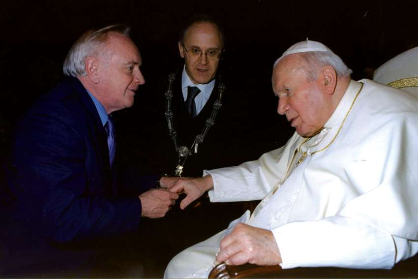 Dr. Robert Walley, left, founder of MaterCare International, meets Pope John Paul II.