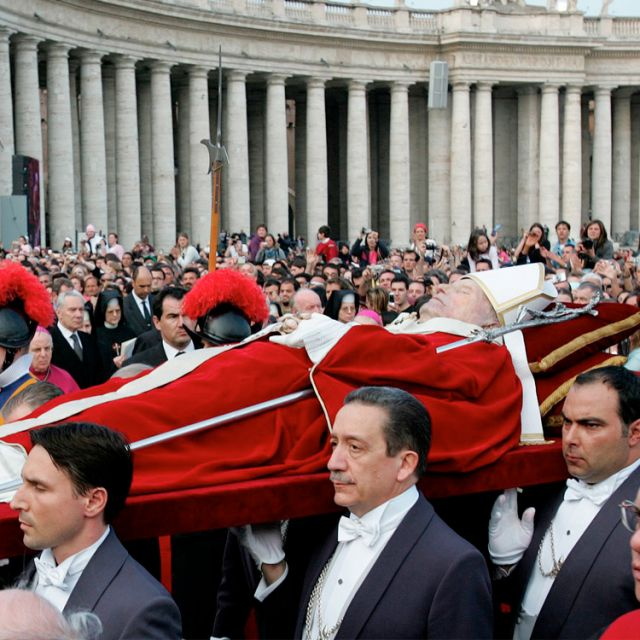 Vatican ushers, including Massimo Sansolini, center, carry the body of Blessed John Paul II through St. Peter's Square at the Vatican in this 2005 file photo.