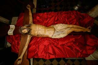 A wooden crucifix from the 14th century is pictured during a media opportunity to showcase its restoration in St. Peter's Basilica at the Vatican Oct. 28. The crucifix is one of the few items that was present in the original St. Peter's Basilica. The restoration was funded by the Knights of Columbus.