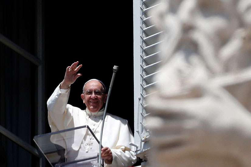 Pope Francis waves as he arrives to lead the Regina Coeli ion St. Peter's Square at the Vatican May 14.