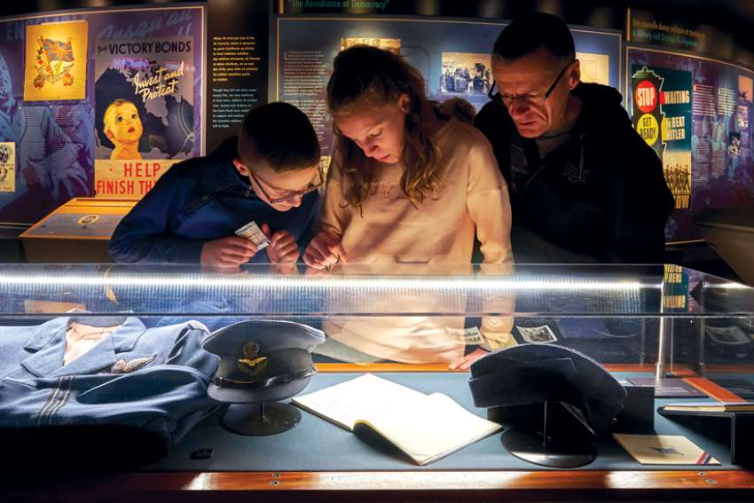 Visitors to the Juno Beach Centre examine an exhibit.