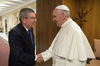 Thomas Bach, president of the International Olympic Committee, greets Pope Francis during their meeting ahead of the opening ceremony of first global conference of faith and sport at the Vatican City, Oct. 5.