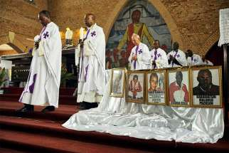 Priests celebrate Mass for citizens killed in recent protests at the Cathedral of Our Lady of Congo in Kinshasa, Congo, Feb. 9.