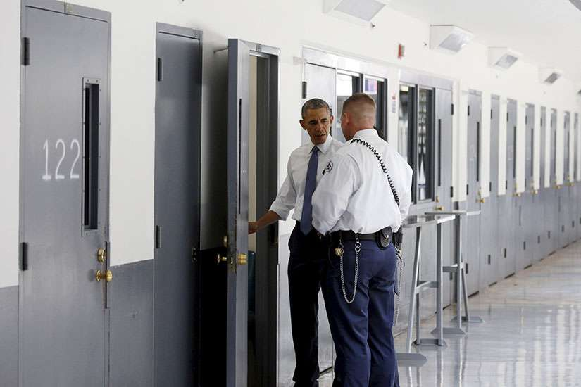 A correctional officer shows U.S. President Barack Obama a cell during a visit to El Reno Federal Correctional Institution outside Oklahoma City July 16. Obama is the first sitting president to visit a federal prison.