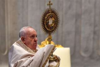 Pope Francis leads Benediction at the conclusion of the Mass marking the feast of Corpus Christi in St. Peter's Basilica at the Vatican June 14, 2020. The Mass was celebrated with a small congregation of some 50 people as part of efforts to contain spread of the coronavirus.