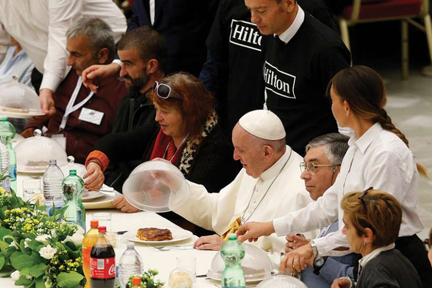 Pope Francis eats lunch with poor people as he marks World Day of the Poor at the Vatican Nov. 18. Some 1,500 people joined the Pope for lunch in Paul VI hall.