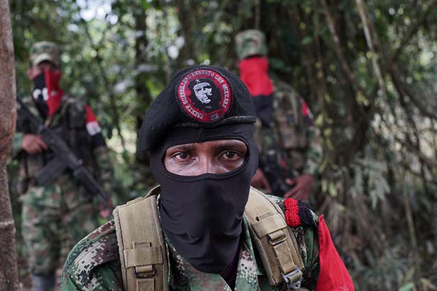 Yerson, the commander of the National Liberation Army, is photographed Aug. 30 in the northwestern jungles of Colombia.