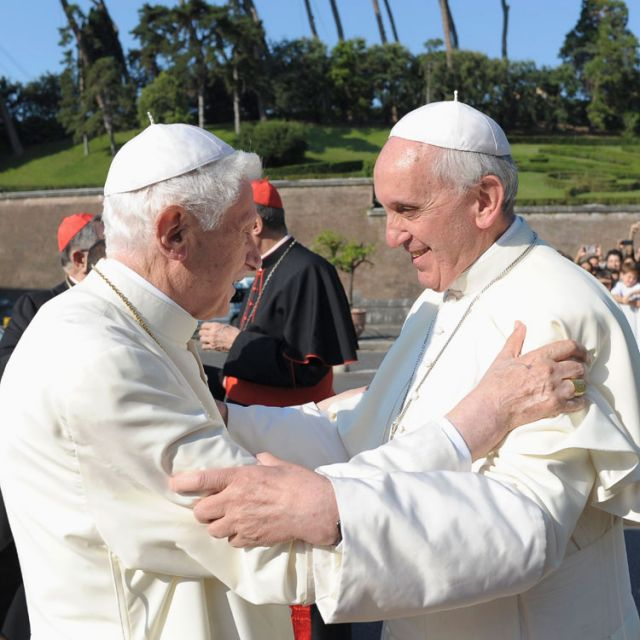 ope Francis, right, embraces retired Pope Benedict XVI during a ceremony in the Vatican gardens July 5. During the service, Pope Francis blessed a new statue of St. Michael the Archangel and recited separate prayers to consecrate Vatican City to St. Jo seph and to St. Michael.