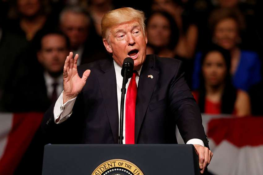 U.S. President Donald Trump announces his Cuba policy July 16 at the Manuel Artime Theater in Little Havana, a neighborhood of Miami.