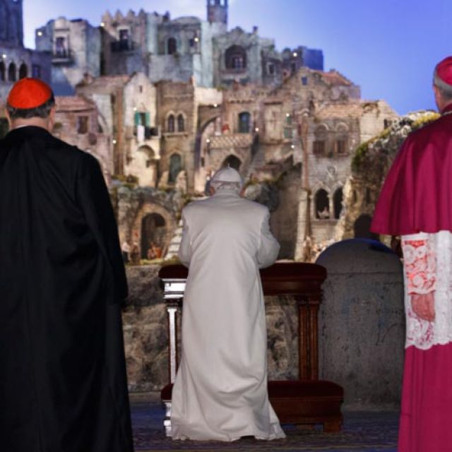 Pope Benedict XVI prays at the Nativity scene in St. Peter's Square after leading vespers in St. Peter's Basilica on New Year's Eve at the Vatican Dec. 31.