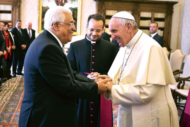 Pope Francis greets Palestinian President Mahmoud Abbas during a private audience in the Apostolic Palace at the Vatican May 16.