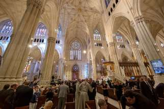 People fill the pews before the start of a prayer service led by Pope Francis at St. Patrick's Cathedral in New York Sept. 24.