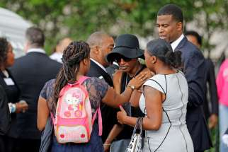 Family members comfort Diamond Reynolds, the girlfriend of Philando Castile, as his casket arrives July 14 for a funeral service at the Cathedral of St. Paul in St. Paul, Minn. Church officials said the mother of 32-year-old man, who was not Catholic, requested the cathedral hold an ecumenical service for her son. Castile was shot and killed by a police officer July 6.