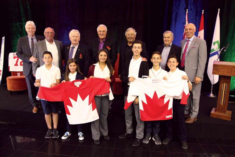 Team Canada members from the 1972 Summit Series (back row) pose with select students from the Niagara Catholic school board. The board struck a curriculum development partnership with the team.