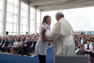 "Pope Francis greets a woman during his visit with Giovanni Traettino, a Protestant pastor and his friend, in Caserta, Italy, July 28. Pope Francis said he knew people would be shocked that he would make such a trip outside of Rome to visit a group of Pen tecostals, ""but I went to visit my friends."""