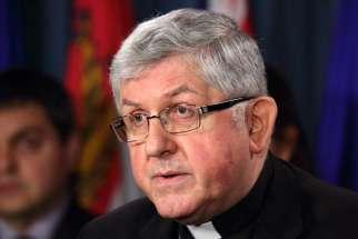 Cardinal Thomas Collins of Toronto speaks out against euthanasia and physician-assisted suicide during an April 19 news conference on Parliament Hill in Ottawa, Ontario. The Cardinal released a statement on June 20 responding to the passing of Bill C-14