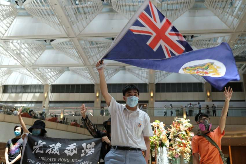 A pro-democracy demonstrator waves the British colonial Hong Kong flag during a protest against new national security legislation in Hong Kong June 1, 2020.