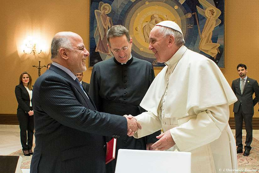 Pope Francis shakes hands with Iraqi Prime Minister Haider al-Abadi during a Feb. 10 meeting at the Vatican.