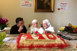 Sister Candida Bellotti, center, at the celebration in Italy for her 110th birthday on Feb. 20, 2017.