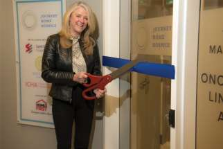 The Journey Home Hospice went from four to 10 beds in a renovated and expanded space in Toronto. St. Elizabeth Foundation director Nancy Lefebre cuts the ribbon.