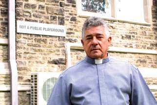 Fr. Carlos Augusto Sierra Tobon has seen some community backlash to the sign he posted on St. Brigid's to deal with some unwanted activities on church property.