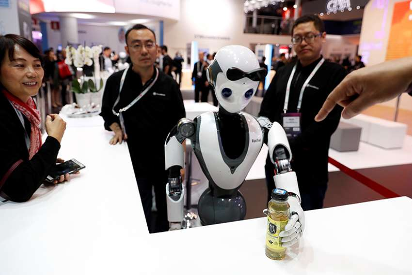 The CloudMinds XR-1 robot performs for visitors at the Mobile World Congress in Barcelona, Spain Feb. 25, 2019. Technology holds the potential to benefit all of humankind, but it also poses risky and unforeseen results, Pope Francis said.